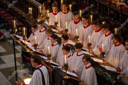 Choristers in King's College Chapel,Cambridge,rehearsing for the Festival of Nine Lessons and Carols,which is sung on Christmas Eve and shown on the BBC.