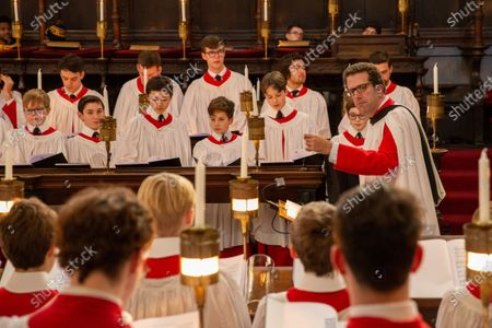 Daniel Hyde the new director of music with the Choristers in King's College Chapel,Cambridge,rehearsing for the Festival of Nine Lessons and Carols,which is sung on Christmas Eve and shown on the BBC.