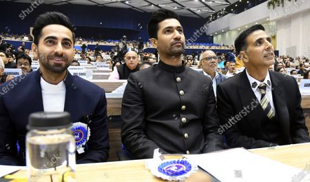 Bollywood actors Ayushmann Khurrana (L), Vicky Kaushal (C) and Akshay Kumar (R) attend the presentation for 66th National Film Awards in New Delhi, India, 23 December 2019.