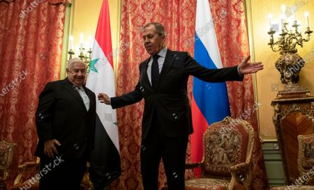 Russian Foreign Minister Sergey Lavrov (R) welcomes Minister of Foreign Affairs and Expatriates of the Syrian Arab Republic Walid Muallem (L) during their meeting in Moscow, Russia, 23 December 2019.