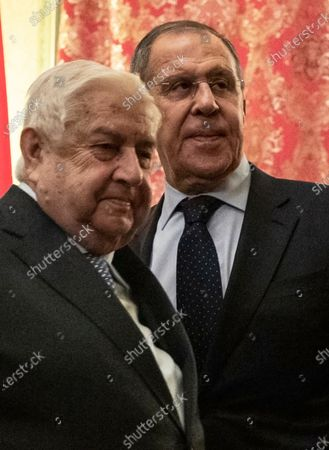 Russian Foreign Minister Sergey Lavrov (R) enters a hall with Minister of Foreign Affairs and Expatriates of the Syrian Arab Republic Walid Muallem (L) during their meeting in Moscow, Russia, 23 December 2019.