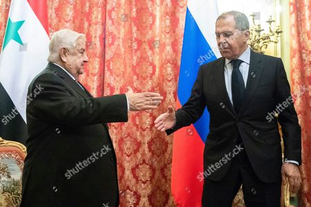 Walid Muallem, Sergey Lavrov. Syrian Foreign Minister Walid Muallem, left, and Russian Foreign Minister Sergey Lavrov shake hands during their meeting in Moscow, Russia