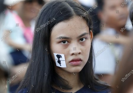 A woman with a sticker on her cheek reading 'Justice for Victoria' takes part in a protest calling for justice for a two-year-old girl who was allegedly raped last May at her nursery, in Yangon, Myanmar, 23 December 2019. Victoria is the nickname that people in Myanmar have given the young girl. The rape case, believed to have happened in Wisdom Hill Nursery School in Naypyidaw, sparked national outrage.