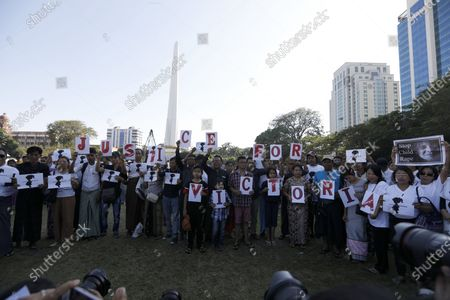 People hold placards and shout slogans during a protest calling for justice for a two-year-old girl who was allegedly raped last May at her nursery, in Yangon, Myanmar, 23 December 2019. Victoria is the nickname that people in Myanmar have given the young girl. The rape case, believed to have happened in Wisdom Hill Nursery School in Naypyidaw, sparked national outrage.