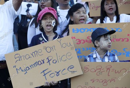 People hold placards as they participate a protest calling for justice for a two-year-old girl who was allegedly raped last May at her nursery, in Yangon, Myanmar, 23 December 2019. Victoria is the nickname that people in Myanmar have given the young girl. The rape case, believed to have happened in Wisdom Hill Nursery School in Naypyidaw, sparked national outrage.