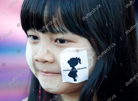 A girl with a sticker on her cheek reading 'Justice for Victoria' takes part in a protest calling for justice for a two-year-old girl who was allegedly raped last May at her nursery, in Yangon, Myanmar, 23 December 2019. Victoria is the nickname that people in Myanmar have given the young girl. The rape case, believed to have happened in Wisdom Hill Nursery School in Naypyidaw, sparked national outrage.