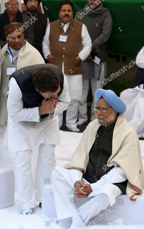 India's main opposition Congress party leader Rahul Gandhi, greets former prime minister Manmohan Singh, right, during a silent protest against a contentious new citizenship law, in New Delhi, India, Monday, Dec.23, 2019. More than twenty people have been killed nationwide since the law was passed in Parliament earlier this month in protests that represent the first major roadblock for Prime Minister Narendra Modi's Hindu nationalist agenda since his party's landslide re-election last spring