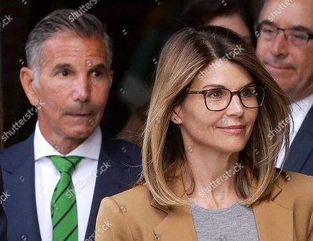 Lori Loughlin, Mossimo Giannulli. Actress Lori Loughlin, front, and her husband, clothing designer Mossimo Giannulli, left, depart federal court in Boston after facing charges in a nationwide college admissions bribery scandal. The couple mounted a defense after being accused of paying $500,000 to get their two daughters into the University of Southern California as recruits to the crew team, even though neither participated in the sport