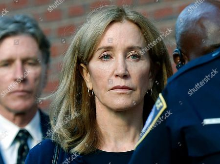 Felicity Huffman, Moore Huffman Jr. Actress Felicity Huffman leaves federal court in Boston with her brother Moore Huffman Jr., left, after she was sentenced in a nationwide college admissions bribery scandal. Huffman was sentenced to 14 days in federal prison in Dublin, Calif., but was released early after serving 10 days