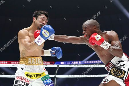 Moruti Mhtalane, Akira Yaegashi. South African champion Moruti Mhtalane, right, sends a right to Japanese challenger Akira Yaegashi in the third round of their IBF flyweight world boxing title match in Yokohama, southwest of Tokyo,. Mhtalane defended his title by a technical knockout in the ninth round