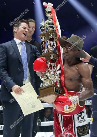South African champion Moruti Mhtalane holds his trophy after beating Japanese challenger Akira Yaegashi in their IBF flyweight world boxing title match in Yokohama, southwest of Tokyo,. Mhtalane defended his title by a technical knockout in the ninth round