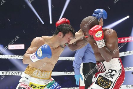 Moruti Mhtalane, Akira Yaegashi. South African champion Moruti Mhtalane, right, and Japanese challenger Akira Yaegashi exchange punches in the fourth round of their IBF flyweight world boxing title match in Yokohama, southwest of Tokyo,. Mhtalane defended his title by a technical knockout in the ninth round