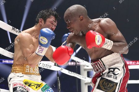 Moruti Mhtalane, Akira Yaegashi. South African champion Moruti Mhtalane, right, sends a right to Japanese challenger Akira Yaegashi in the ninth round of their IBF flyweight world boxing title match in Yokohama, southwest of Tokyo,. Mhtalane defended his title by a technical knockout in the round