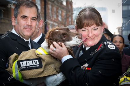 London Fire Commissioner (LFC), Dany Cotton hugs a fire dog as she leaves her final day in office. Hundreds of firefighters lined Union Street in London today to provide a Guard of Honour on the final day in office for London Fire Commissioner, Danny Cotton.