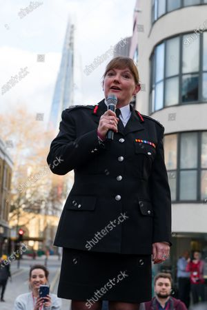 London Fire Commissioner (LFC), Dany Cotton makes a speech from a vintage fire engine after being greeted by members and family of the Fire Brigade on her final day in office. Hundreds of firefighters lined Union Street in London today to provide a Guard of Honour on the final day in office for London Fire Commissioner, Danny Cotton.