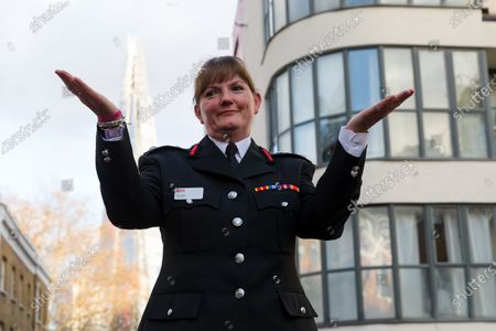 London Fire Commissioner (LFC), Dany Cotton waves after making a speech from a vintage fire engine after being greeted by members and family of the Fire Brigade on her final day in office. Hundreds of firefighters lined Union Street in London today to provide a Guard of Honour on the final day in office for London Fire Commissioner, Danny Cotton.
