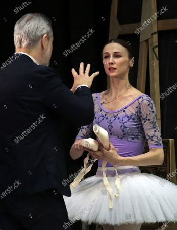 Stock Photo of Russian violinist Vadim Repin (left) and Prima ballerina of Bolshoi Theatre Svetlana Zakharova during the open rehearsal of the joint program on the upper stage of Bolshoi Theatre.
