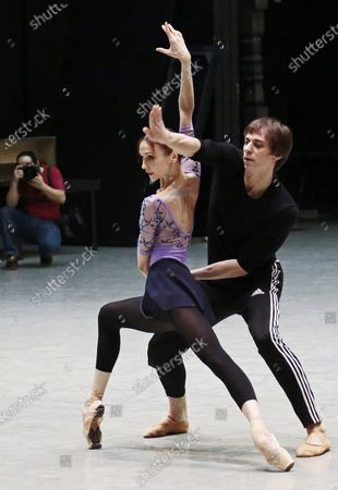 Prima ballerina of Bolshoi Theatre Svetlana Zakharova and Russian ballet dancer Denis Savin perform during the open rehearsal of the joint program on the upper stage of Bolshoi Theatre.