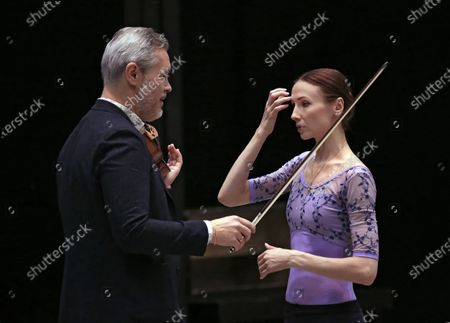 Stock Picture of Russian violinist Vadim Repin (left) and Prima ballerina of Bolshoi Theatre Svetlana Zakharova during the open rehearsal of the joint program on the upper stage of Bolshoi Theatre.