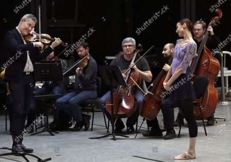 Russian violinist Vadim Repin (left), Prima ballerina of Bolshoi Theatre Svetlana Zakharova (right) and the Moscow Chamber Orchestra 'Musica Viva' during the open rehearsal of the joint program on the upper stage of Bolshoi Theatre.