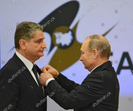 Russian President Vladimir Putin (right) presents Order of Friendship to Chairman of the Board of the Eurasian Economic Commission Tigran Sargsyan (left) during the meeting of Heads of State and Government of member states of the Supreme Eurasian Economic Council in Boris Yeltsin Presidential Library.