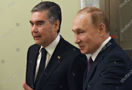 Stock Photo of Russian President Vladimir Putin (right) and President of Turkmenistan Gurbanguly Berdimuhamedow (left) during the meeting of Heads of State and Government of member states of the Supreme Eurasian Economic Council.