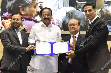Vice President M Venkaiah Naidu, with Minister of Environment, Forest and Climate Change and Minister of Information and Broadcasting Prakash Javadekar, Secretary Ministry of Information and Broadcasting Ravi Mittal present Silver Award for Best Film on Social Issue for Padman to Akshay Kumar