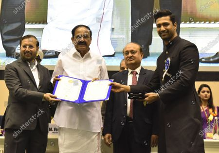 Vice President M Venkaiah Naidu, with Minister of Environment, Forest and Climate Change and Minister of Information and Broadcasting Prakash Javadekar, Secretary Ministry of Information and Broadcasting Ravi Mittal present Best Actor award for URI: The Surgical Strike to Vicky Kaushal