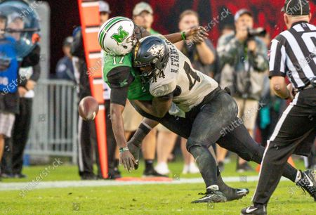 Tampa, FL, U.S: Marshall quarterback Isaiah Green (17) looses the ball after being hit by UCF linebacker Nate Evans (44) during 2nd half of the Bad Boy Mowers Gasparilla Bowl between UCF Knights and the Marshall Thundering Herd. Central Florida defeated -25 at Raymond James Stadium in Tampa, FL