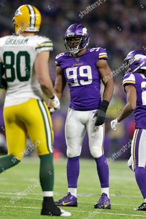 Stock Image of Minnesota Vikings defensive end Danielle Hunter (99) gets set for a play during the second half of an NFL football game against the Green Bay Packers, in Minneapolis