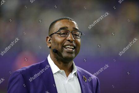 Stock Photo of Former Minnesota Vikings wide receiver Cris Carter stands on the field before an NFL football game between the Vikings and the Green Bay Packers, in Minneapolis
