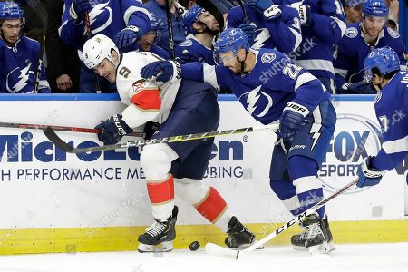 Brian Boyle, Kevin Shattenkirk. Florida Panthers center Brian Boyle (9) vies for the puck with Tampa Bay Lightning defenseman Kevin Shattenkirk (22) during the first period of an NHL hockey game, in Tampa, Fla