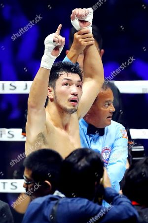 Ryota Murata celebrates winning his bout