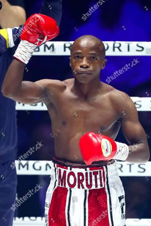 Moruti Mthalane celebrates following the bout