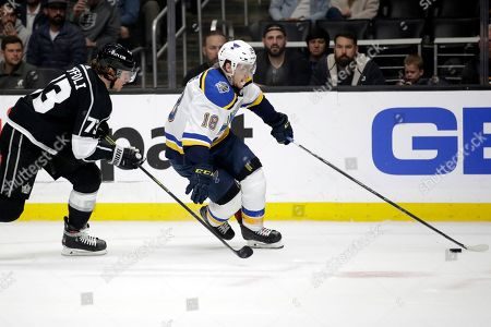St. Louis Blues' Robert Thomas (18) skates in front of Los Angeles Kings' Tyler Toffoli during the first period of an NHL hockey game, in Los Angeles