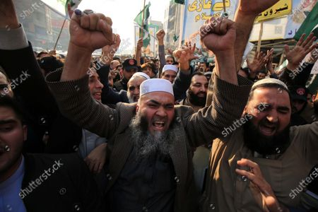 Stock Photo of People shout slogans during protest against sentencing former president Pervez Musharraf to death in high treason case in Peshawar, Pakistan, 24 December 2019. A Pakistan court on 17 December sentenced former president and military ruler Pervez Musharraf to death on charges of committing high treason in 2007 when he suspended the constitution and imposed a state of emergency. Musharraf, 76, has been living in Dubai since he was allowed to leave the country in March 2016 for medical treatment after a three-year travel ban.
