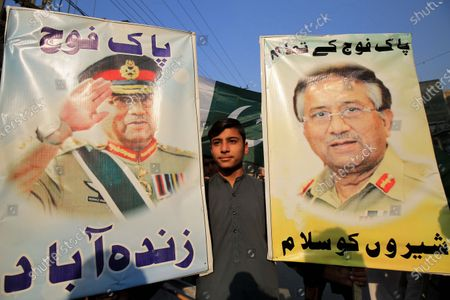 People holds portraits of former President Pervez Musharraf during protest against sentencing Musharraf to death in high treason case in Peshawar, Pakistan, 24 December 2019. A Pakistan court on 17 December sentenced former president and military ruler Pervez Musharraf to death on charges of committing high treason in 2007 when he suspended the constitution and imposed a state of emergency. Musharraf, 76, has been living in Dubai since he was allowed to leave the country in March 2016 for medical treatment after a three-year travel ban.