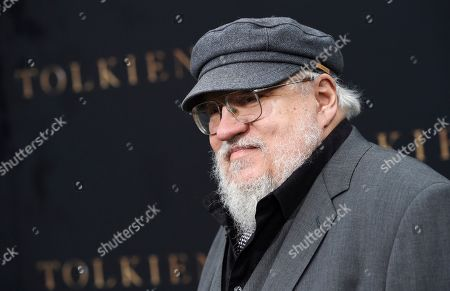 """Stock Image of George R.R. Martin poses at the premiere of the film """"Tolkien"""" at the Regency Village Theatre in Los Angeles. """"Game of Thrones"""" author and television producer George R.R. Martin is adding bookstore owner to his resume. The fantasy writer quietly opened Beastly Books last month in Santa Fe next to the movie theater he revived in 2013, the Santa Fe New Mexican reported"""