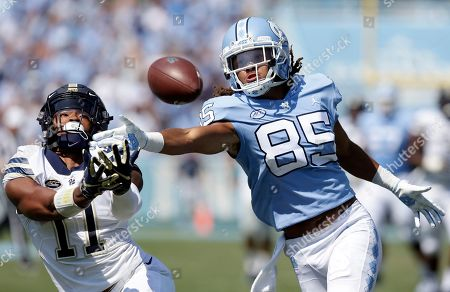 Dane Jackson, Roscoe Johnson. Pittsburgh's Dane Jackson (11) and North Carolina's Roscoe Johnson (85) reach for a pass during the first half of an NCAA college football game in Chapel Hill, N.C. Pittsburgh and Eastern Michigan will meet in the Quick Lane Bowl, on Dec. 26, 2019, hoping to end postseason droughts