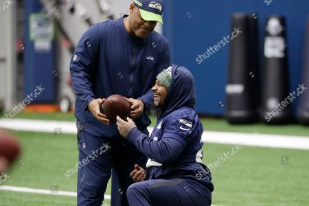 Marshawn Lynch, Ken Norton Jr. Seattle Seahawks running back Marshawn Lynch, right, talks with defensive coordinator Ken Norton Jr. during warmups at the NFL football team's practice facility, in Renton, Wash. When Lynch played his last game for the Seahawks in 2016, the idea of him ever wearing a Seahawks uniform again seemed preposterous. Yet, here are the Seahawks getting ready to have Lynch potentially play a major role Sunday against San Francisco with the NFC West title on the line