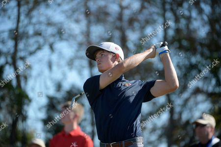 Leo Goosen, son of Retief Goosen, watches after hitting a tee shot on the eighth hole during the first round of the Father Son Challenge golf tournament, in Orlando, Fla