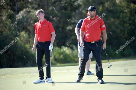 Padraig Harrington, right, and his son, Paddy Harrington, set up to putt on the seventh green during the first round of the Father Son Challenge golf tournament, in Orlando, Fla