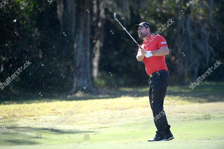 Padraig Harrington hits from the seventh fairway during the first round of the Father Son Challenge golf tournament, in Orlando, Fla
