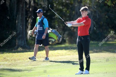 Paddy Harrington, son of Padraig Harrington, sets up for a shot from the seventh fairway during the first round of the Father Son Challenge golf tournament, in Orlando, Fla