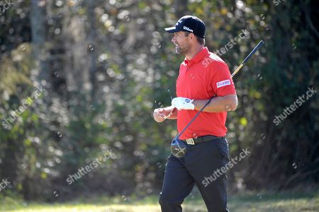 Padraig Harrington walks to the seventh green after hitting from the fairway during the first round of the Father Son Challenge golf tournament, in Orlando, Fla