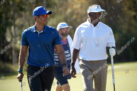 Stock Picture of Qass Singh, left, and his father, Vijay Singh, walk off the seventh green after making their putts during the first round of the Father Son Challenge golf tournament, in Orlando, Fla