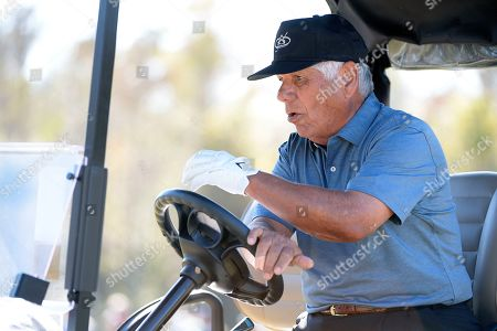 Lee Trevino drives a cart to the eighth hole after making a putt on the seventh green during the first round of the Father Son Challenge golf tournament, in Orlando, Fla