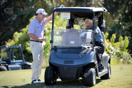 Tom Watson, left, and Lee Trevino chat while waiting to hit their tee shots on the eighth hole during the first round of the Father Son Challenge golf tournament, in Orlando, Fla