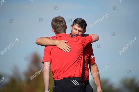 Stock Picture of Padraig Harrington, right, congratulates his son Paddy Harrington after putting on the 18th green during the first round of the Father Son Challenge golf tournament, in Orlando, Fla