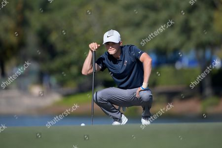 Leo Goosen, son of Retief Goosen, lines up his putt on the 18th green during the first round of the Father Son Challenge golf tournament, in Orlando, Fla